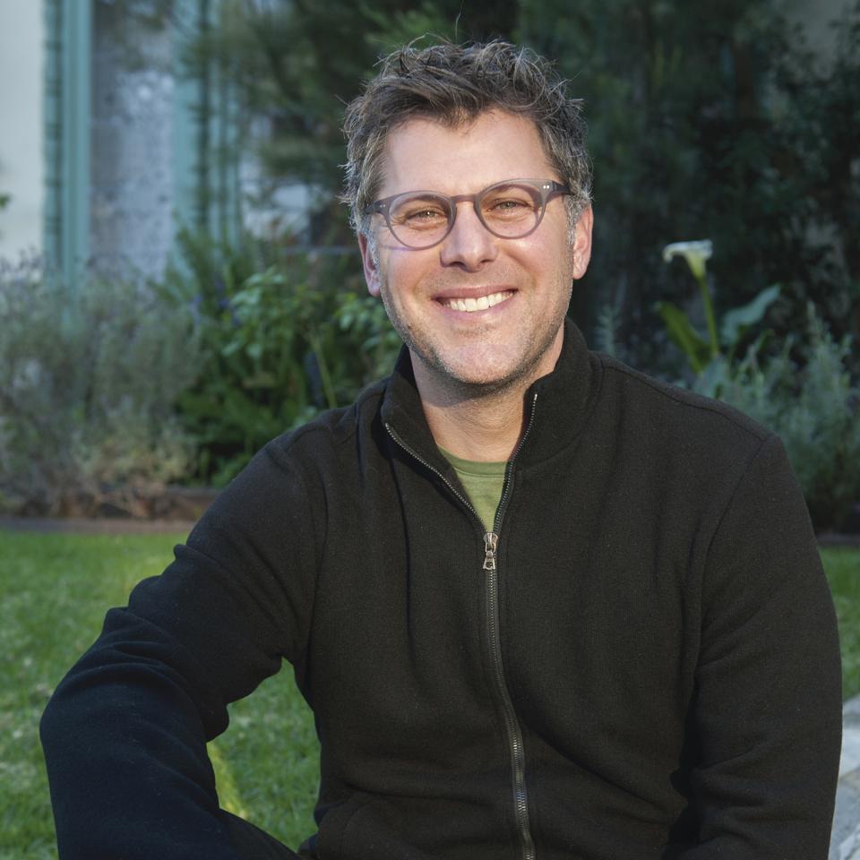 Male sitting in a black sweater