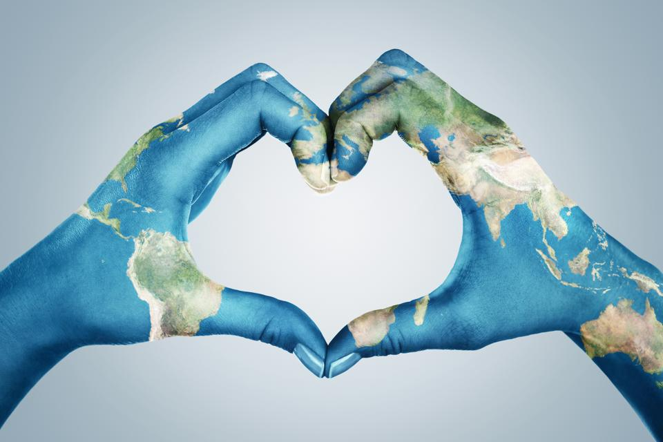 Female hands, painted in the world map,  forming heart shape. Element of this image furnished by NASA ( https://earthobservatory.nasa.gov/blogs/elegantfigures/2011/10/06/crafting-the-blue-marble/ )