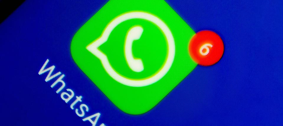 In this photo illustration an icon of WhatsApp app displayed...