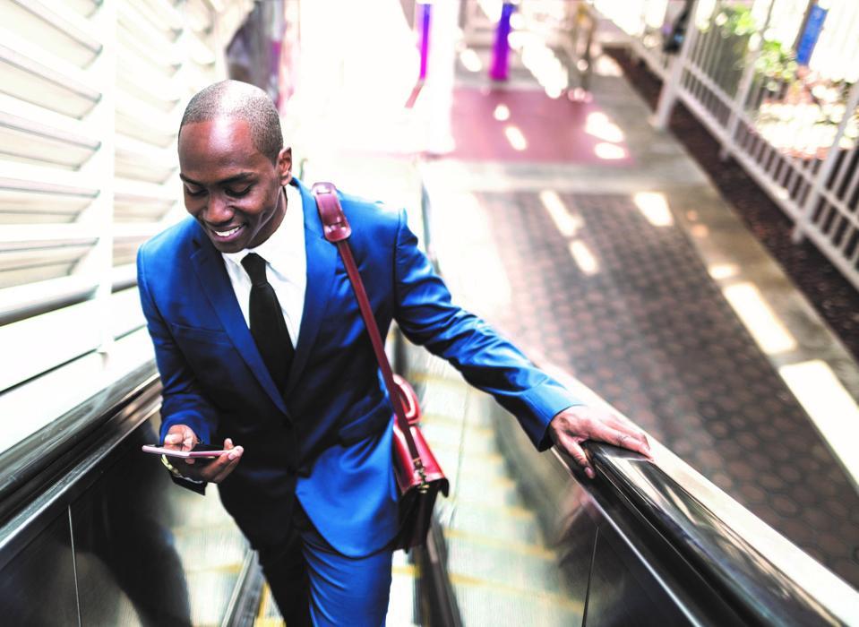 businessman on escalator
