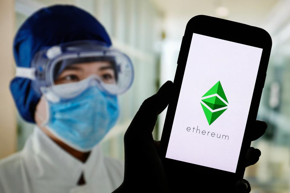 In this photo illustration an Ethereum cryptocurrency logo...
