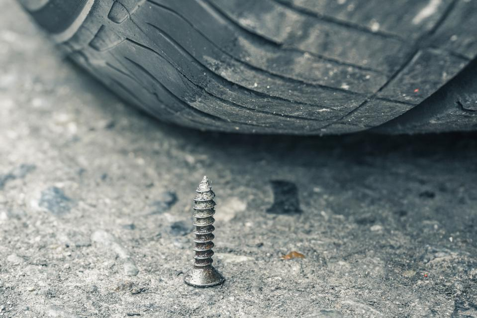 Metal spike and tire
