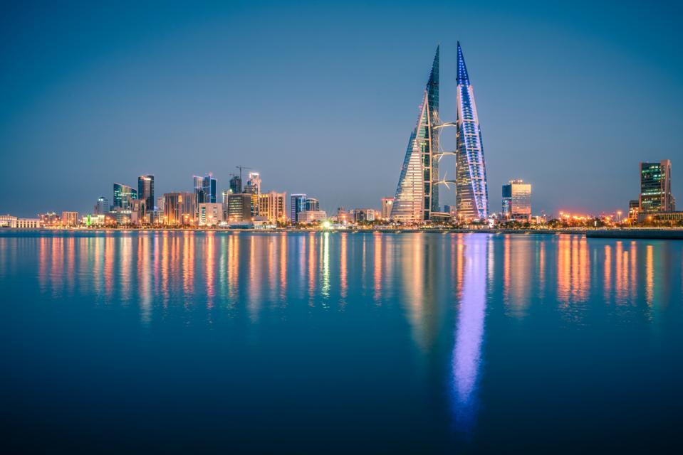 The Skyline of Illuminated Manama City Waterfront at Night, Manama City, Bahrain