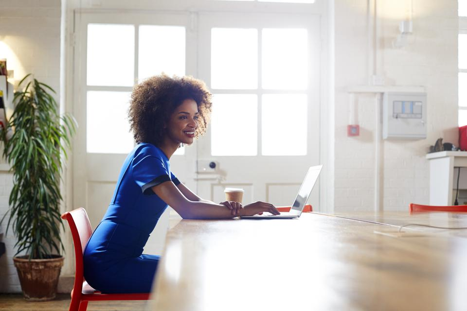 Woman working at home in trendy apartment.