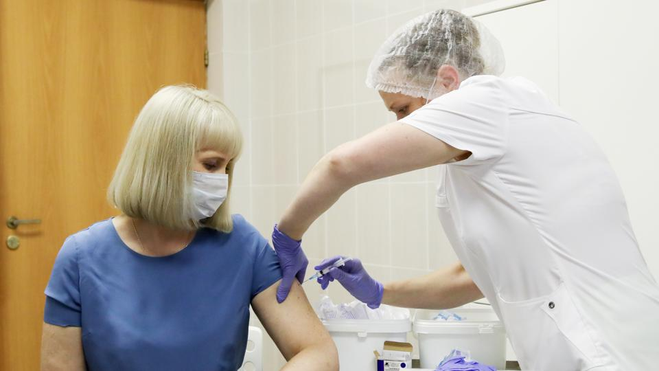 Volunteers take part in post-registration phase trials of Russia's COVID-19 vaccine