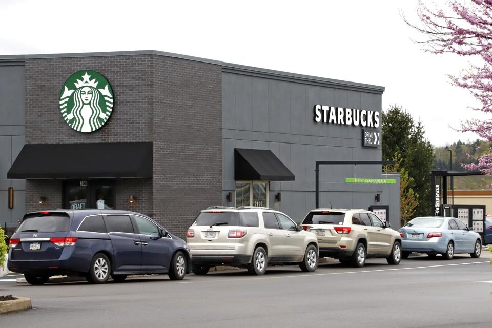 Cars in a Starbucks line.