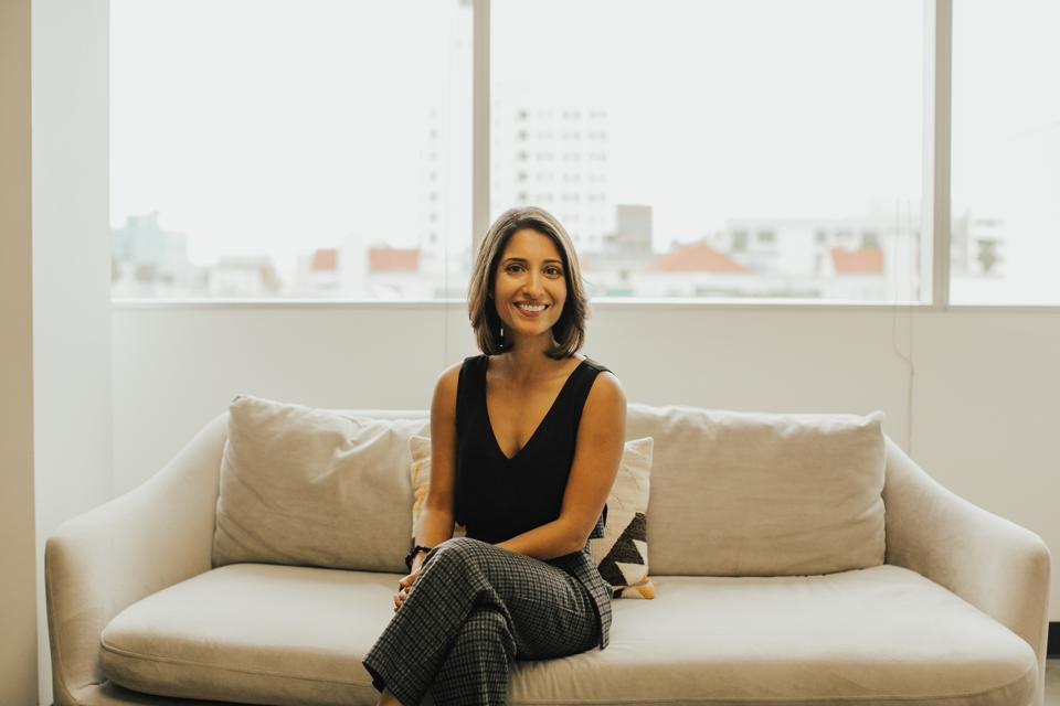 A woman sits on a couch