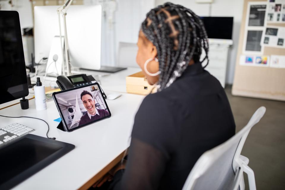 Businesswoman having a video call with a colleague at office.