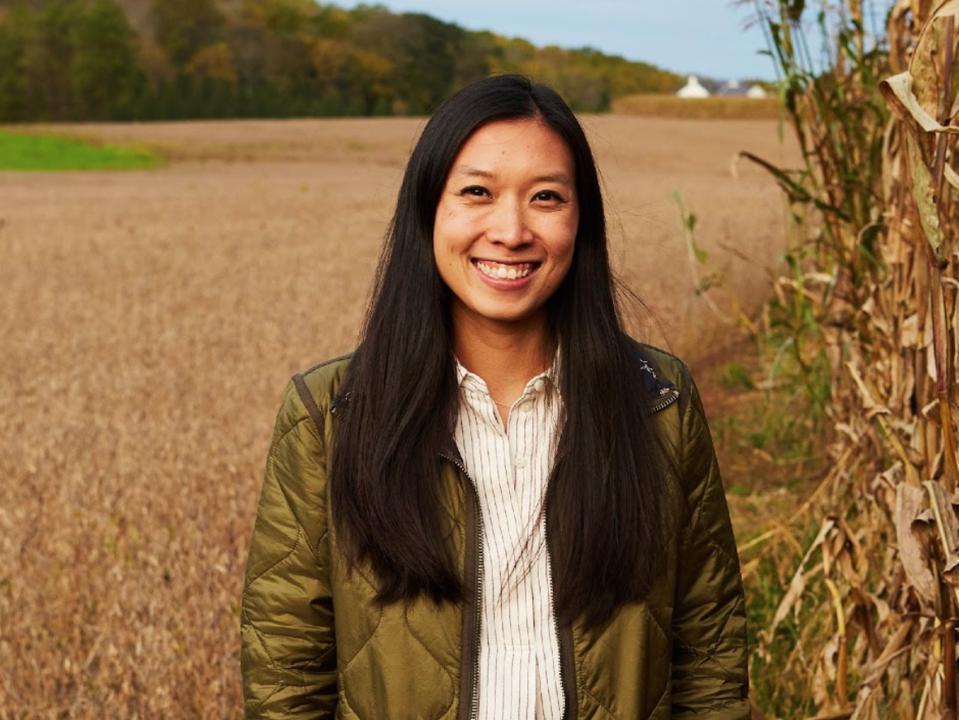 Headshot of Tsou in a field of corn.