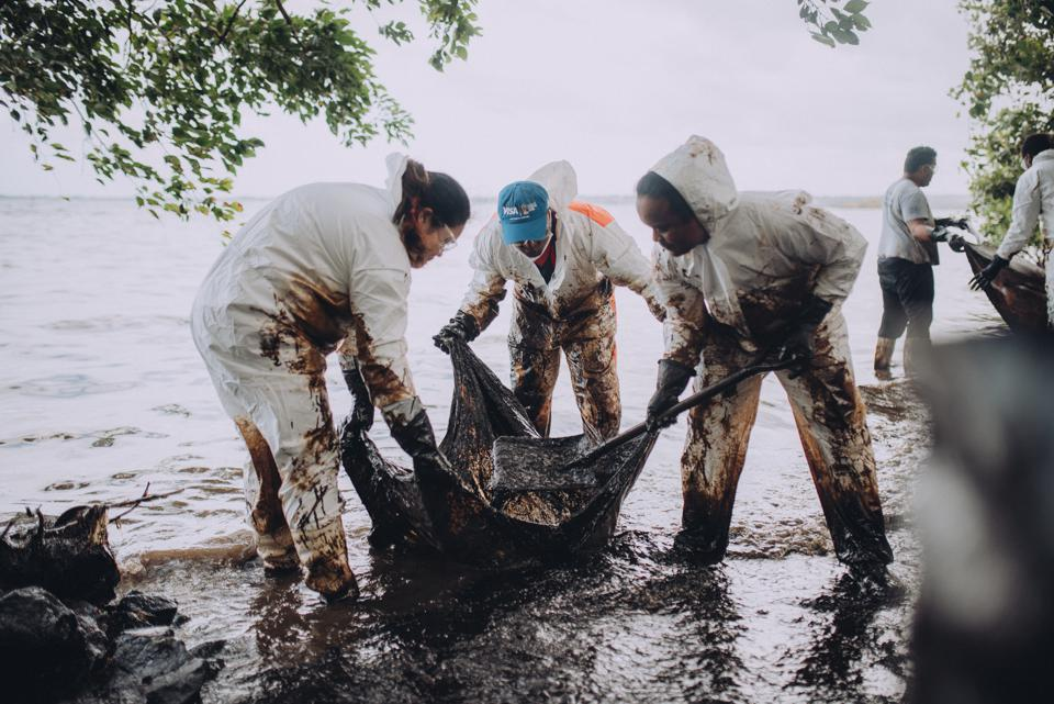 Women were on the front line of the oil spill clean up across Mauritius, as seen here in South East Mauritius soon after the Wakashio started spilling out its cargo of toxic oil.