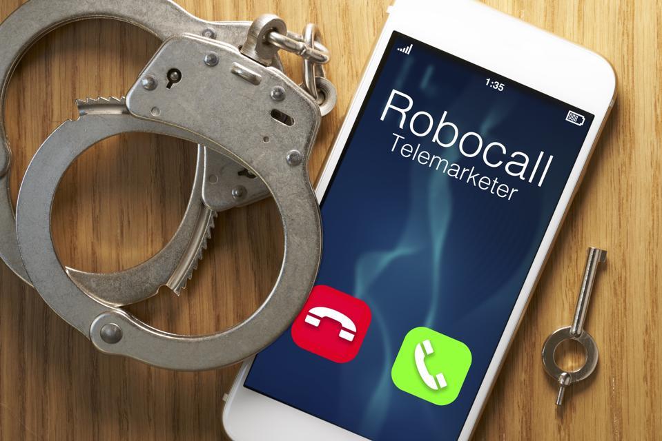 Telemarketer robocall scam: legislation for smartphone with gavel