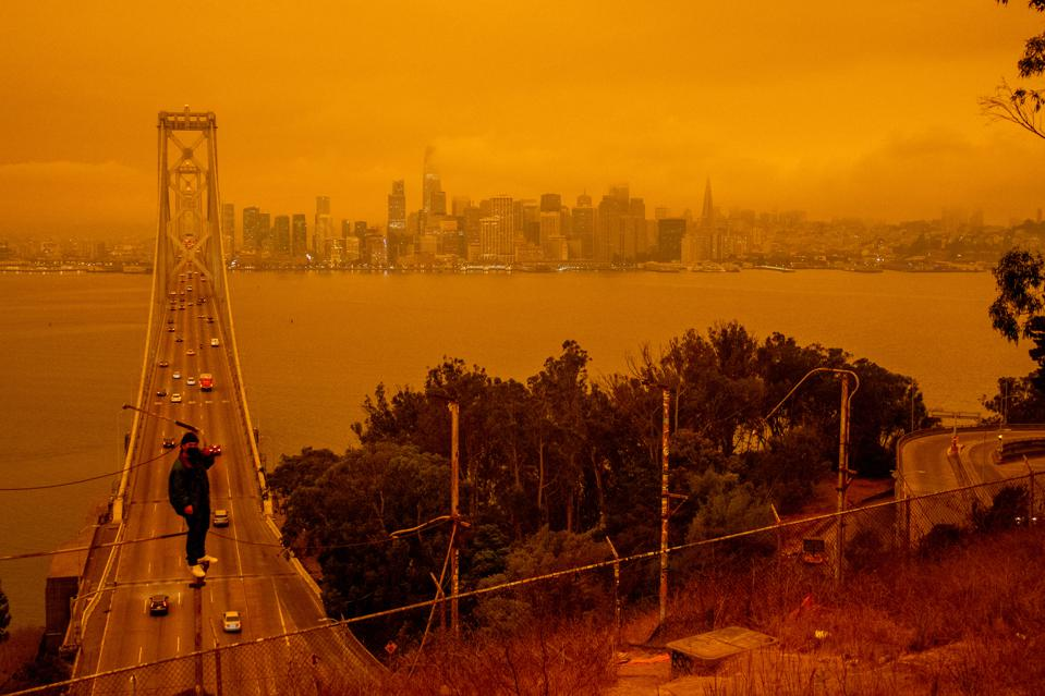 Red-Orange Skies from the Northern California Wildfires Blanket San Francisco Bay Area