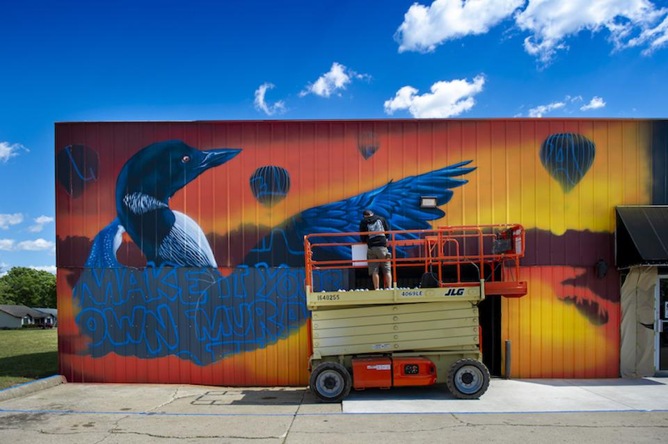 For the ″Make It Your Own Mural Fest″ in Northeast Indiana, Justin Suarez of Rochester, N.Y. completes his mural in Angola.