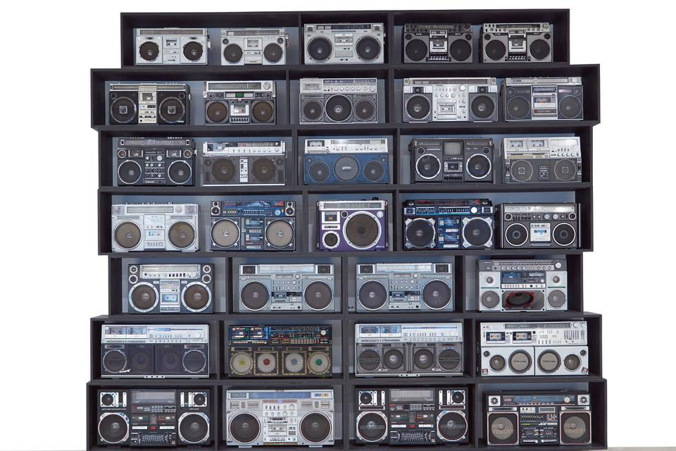 "DJ Ross One ""The Wall of Boom″ installation of 32 vintage boomboxes. It sold for $113,400"