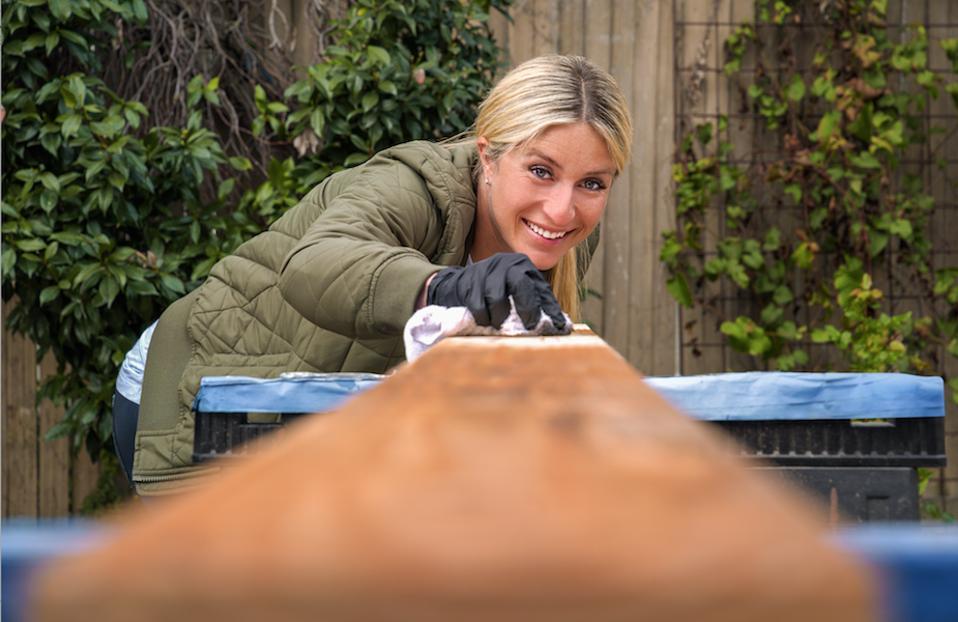 Jasmine Roth cutting wood