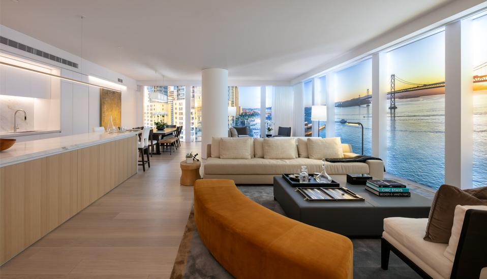 A sleek residential unit with floor-to-ceiling windows overlooking the San Francisco Bay.