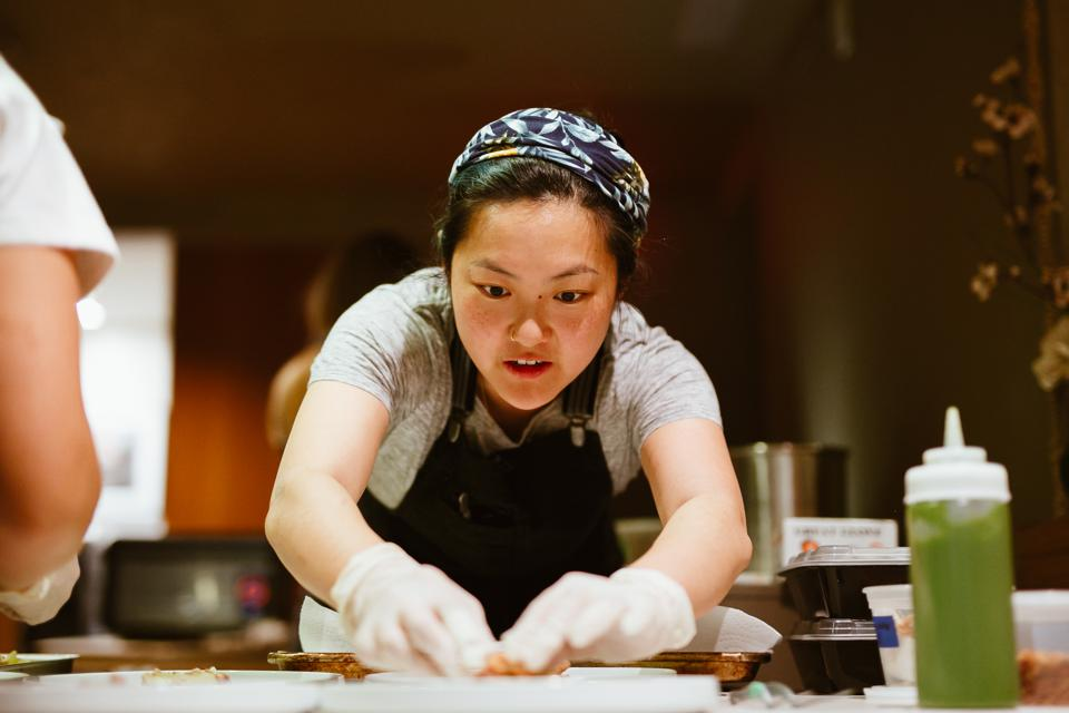 Chef Jenny Dorsey carefully plates her creations during her event, Asian in America.