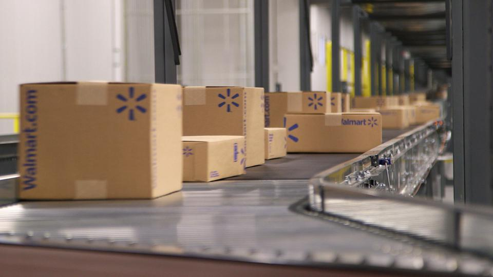 Walmart shipping boxes on conveyor belt