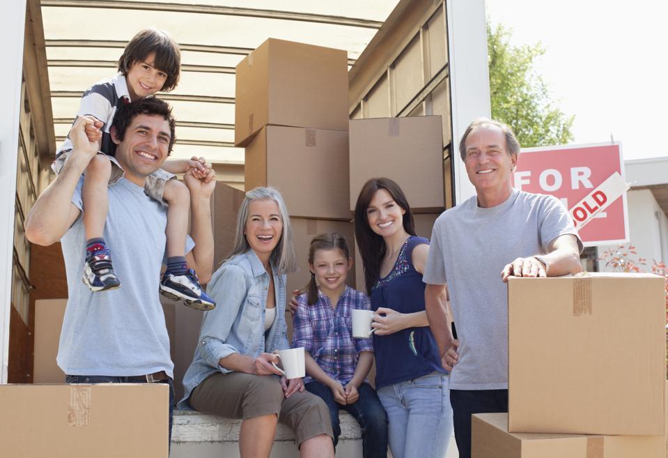 Family taking break near moving van