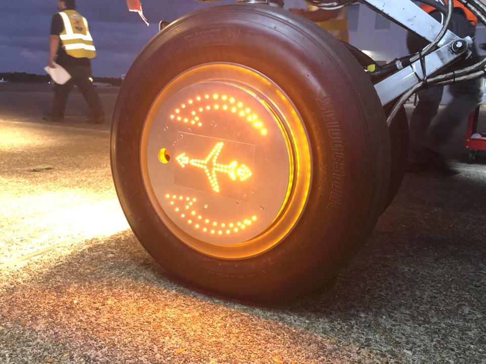 WheelTug aircrat wheel lit up.
