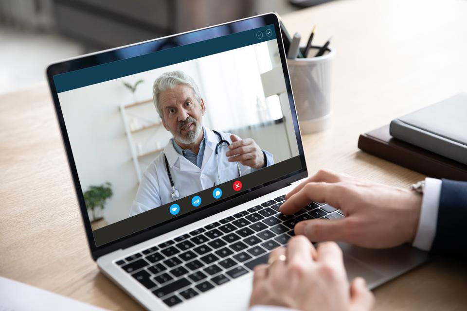 Male patient consult talk with doctor on video call