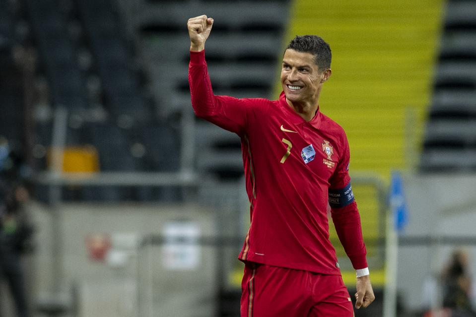 Cristiano Ronaldo celebrates scoring for Portugal against Sweden.