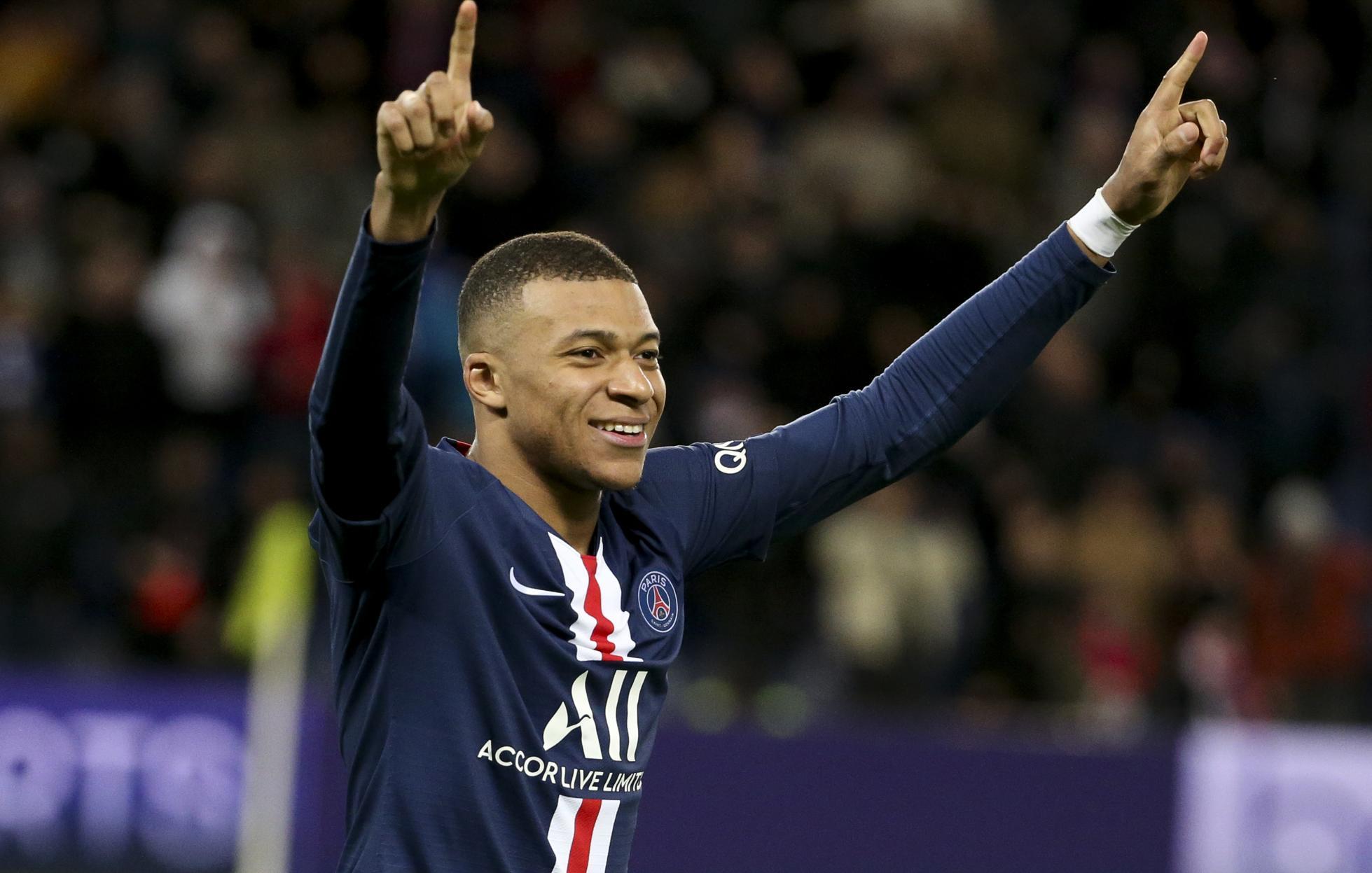 Kylian Mbappe celebrates scoring a goal.