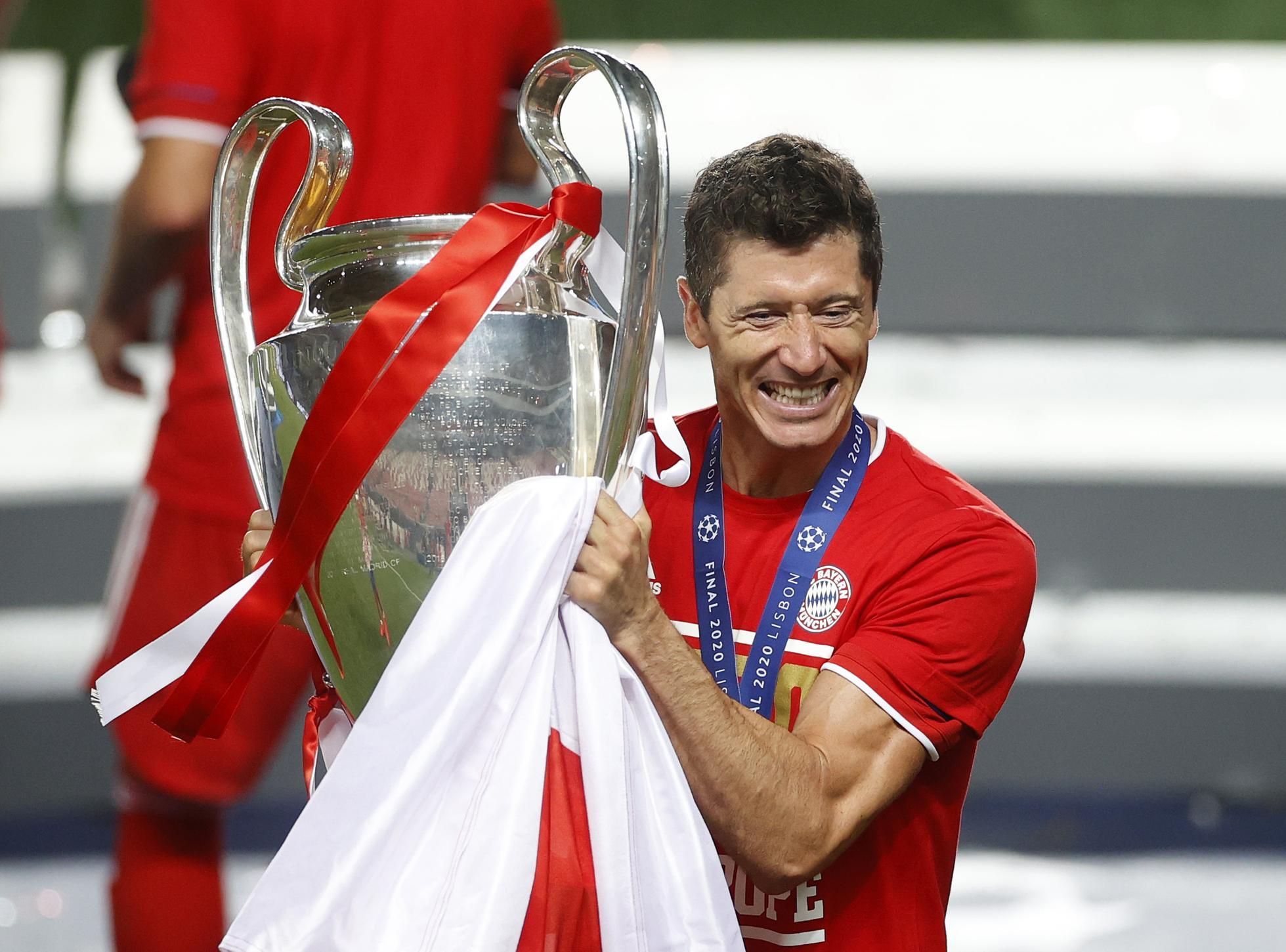 Robert Lewandowski of FC Bayern Munich with the UEFA Champions League Trophy following his team's victory over Paris Saint-Germain.