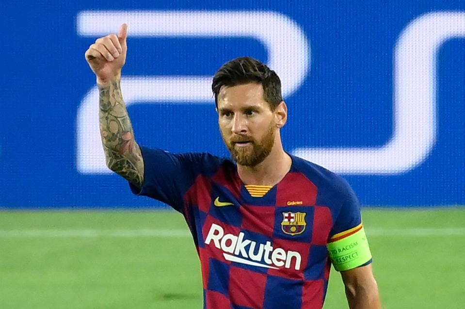 Lionel Messi celebrating scoring a goal in the 2019-20 UEFA Champions League competition.