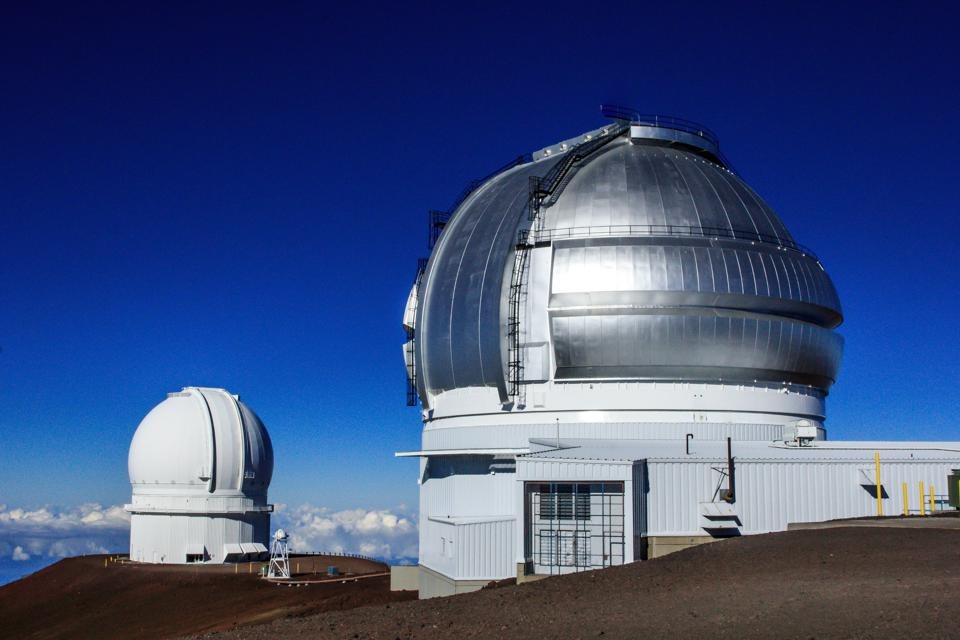 The Canada-France-Hawaii and Gemini Telescopes located at the Mauna Kea Observatories on the Big Island of Hawaii.