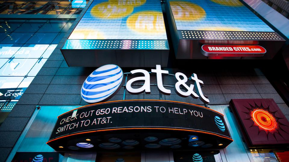 AT&T Inc. signage is displayed at the company's store in the Times Square area of New York, U.S., on Saturday, Oct. 22, 2016.