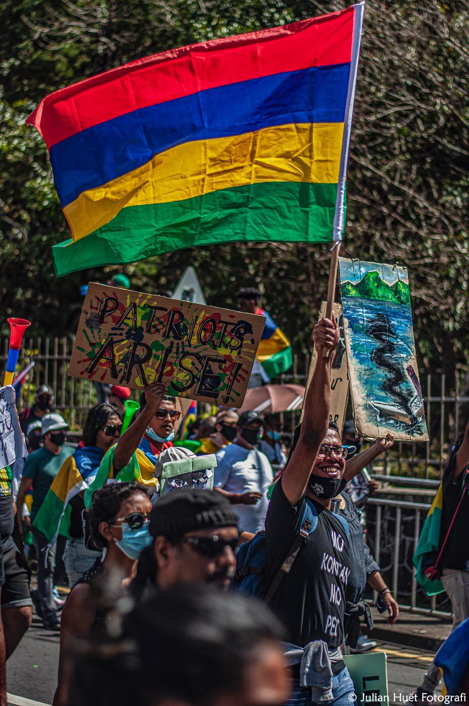 12 September 2020: protestors in Mahebourg waving the Mauritian flag