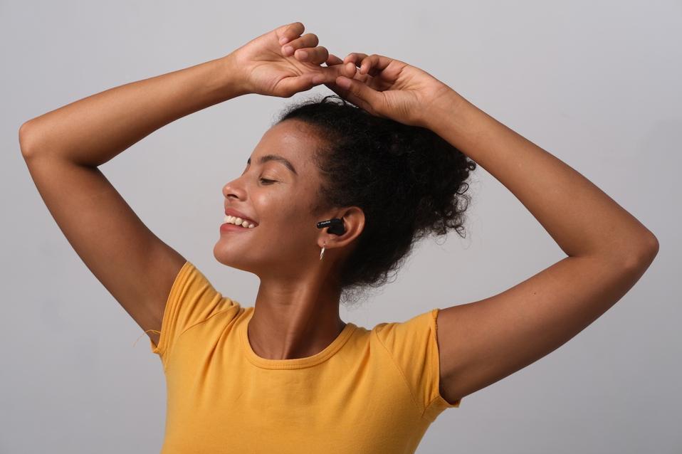 Woman listening to PaMu Quiet earphones