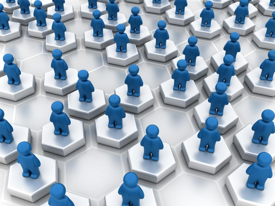 graphic of blue people figures standing on hexagons representing the concept of networking