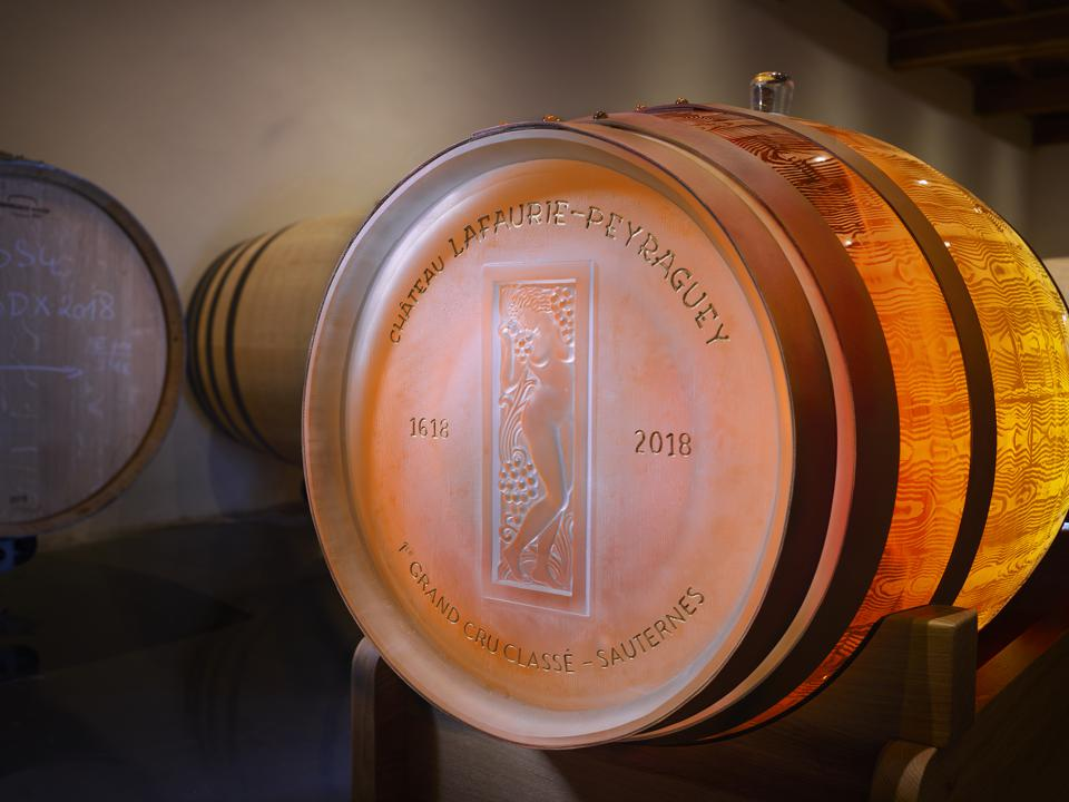 The Lalique crystal wine barrel bearing the signature woman and grapes motif