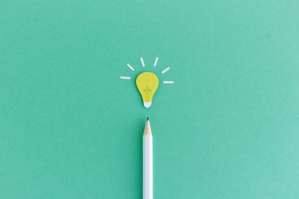 Pencil with light bulb above