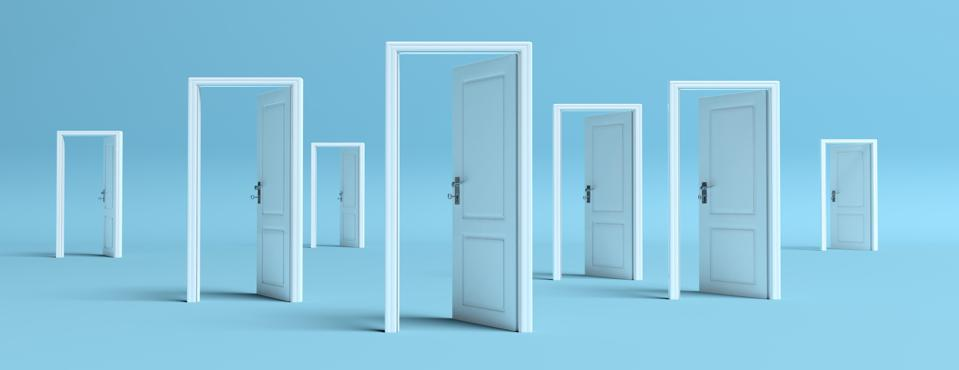 White doors opened to illustrate doors to opportunity