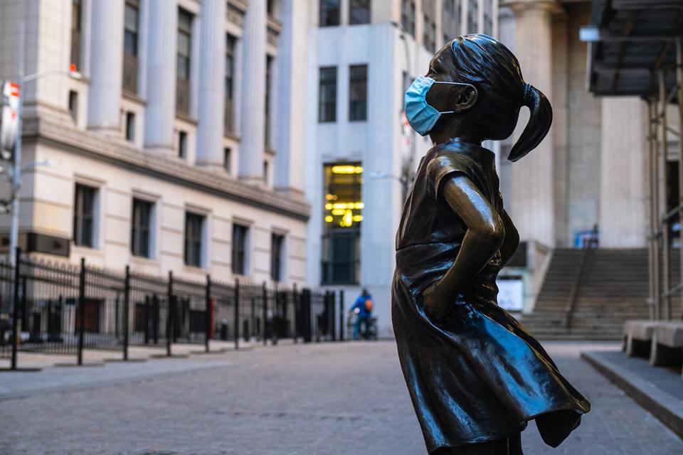 Brave girl statue wearing a mask.