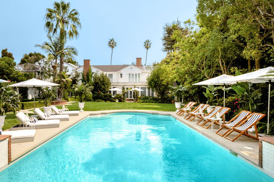 An opulent, turquoise pool behind a Los Angeles County mansion.