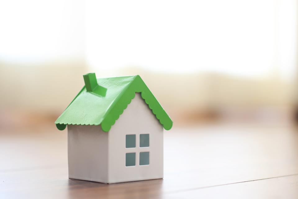 Miniature model house on floor
