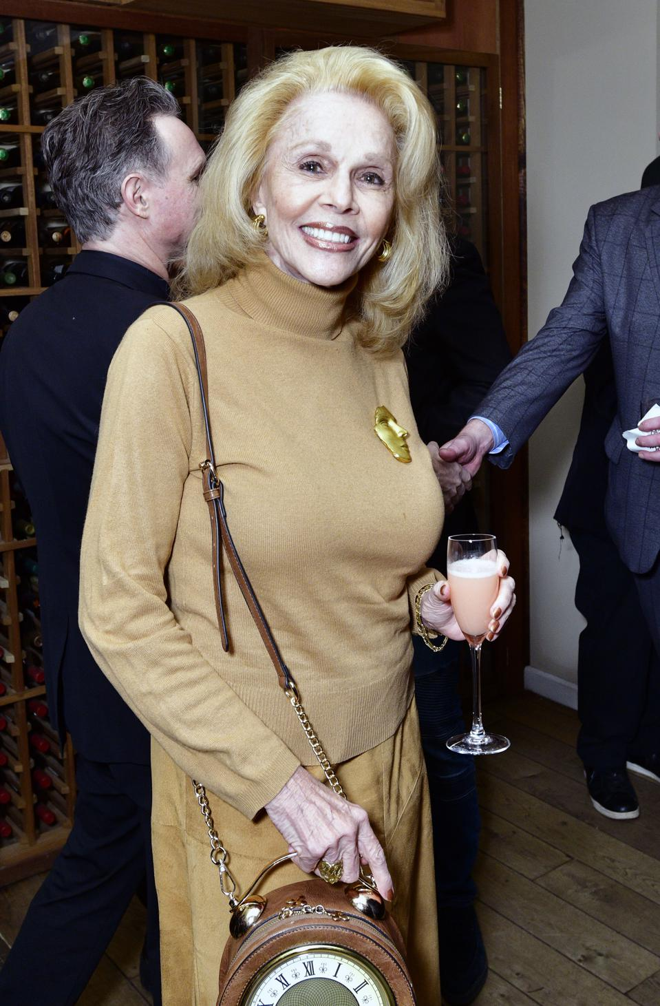 Comedic writer, Susan Silver, with her clock purse which sparked a conversation at a networking event.