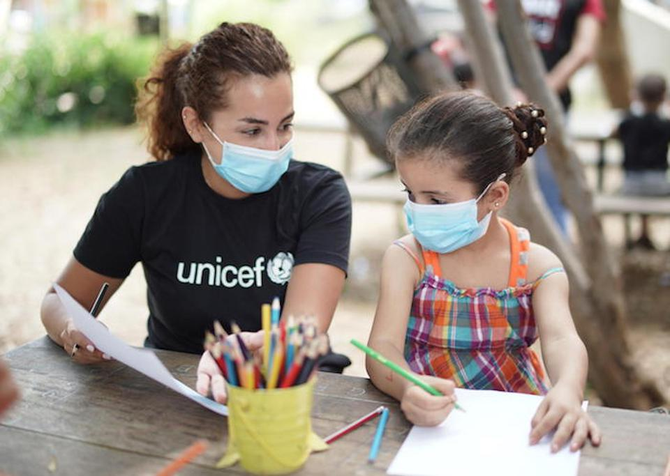 On September 1, 2020, a girl draws with a counselor at a Child-Friendly Space that UNICEF set up inside a public garden in the Karantina