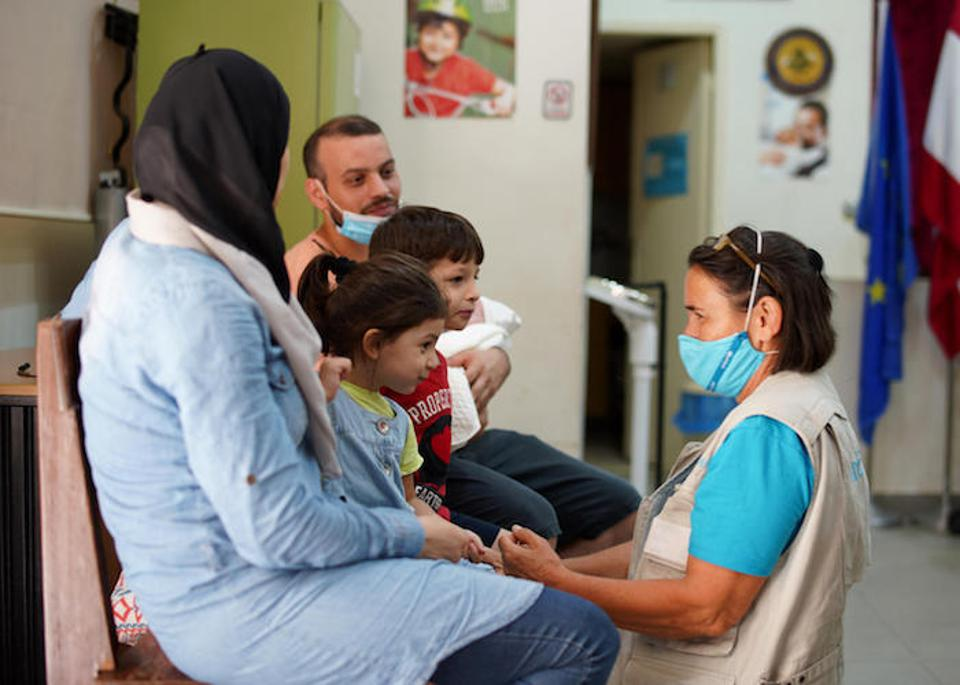 On August 10, 2020, at a health center in Beirut, a UNICEF doctor provides comfort and health care to a family affected by the port explosion.