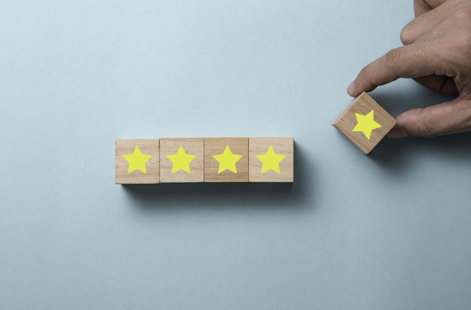 Hand putting five yellow stars