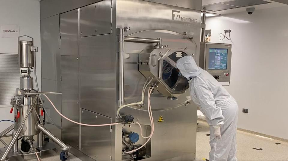 Worker checks on the progress of baricitinib manufacturing process.