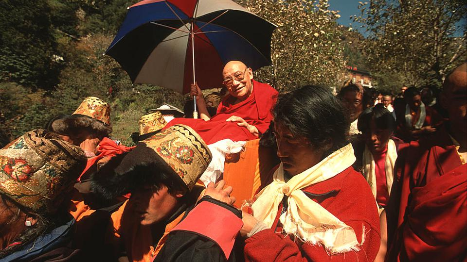 Buddhist abbot Trulshik Rinpochee  is carried en route to Chiwong Monastery