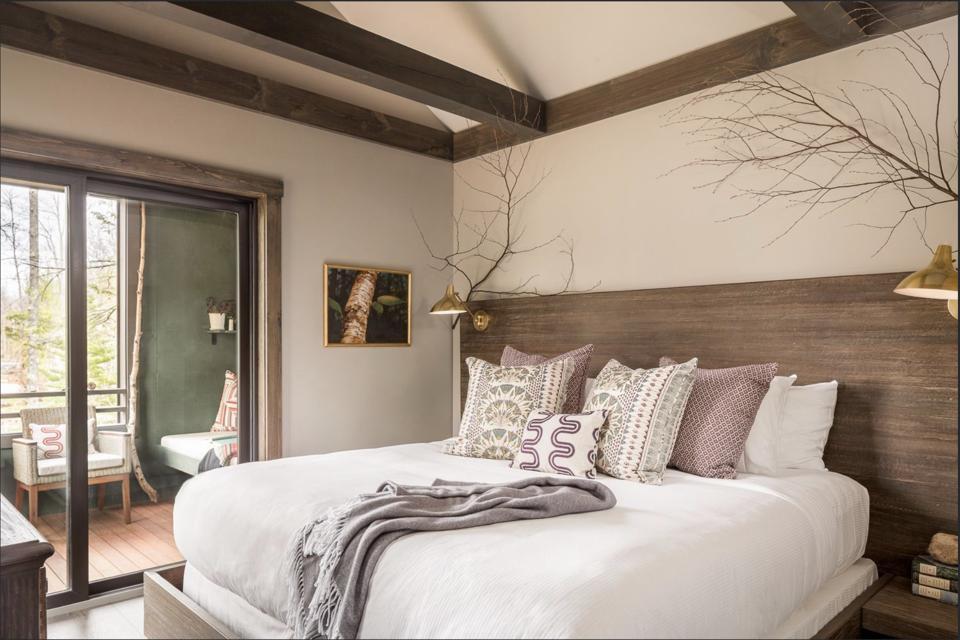 A bedroom in Hidden Pond's new treetop lodge.