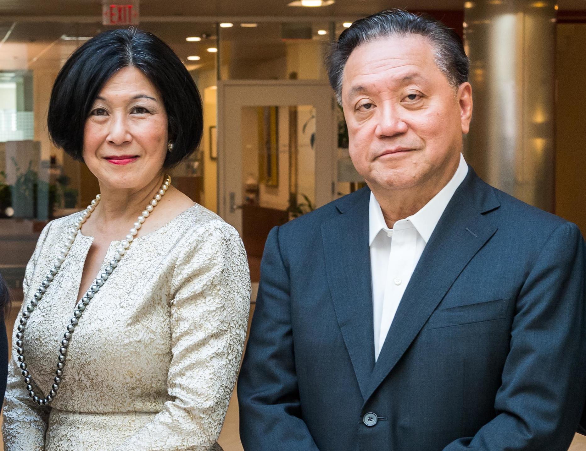 Lisa Yang (L) and Hock Tan