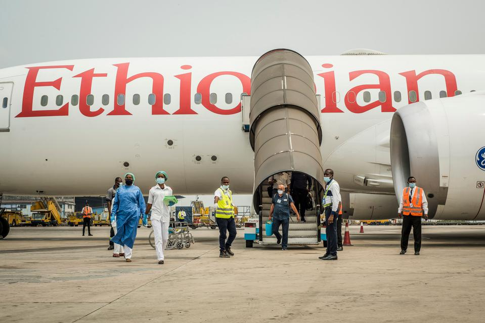 Passengers disembark from an Ethiopian Airlines flight in Kinshasa on August 15, 2020.