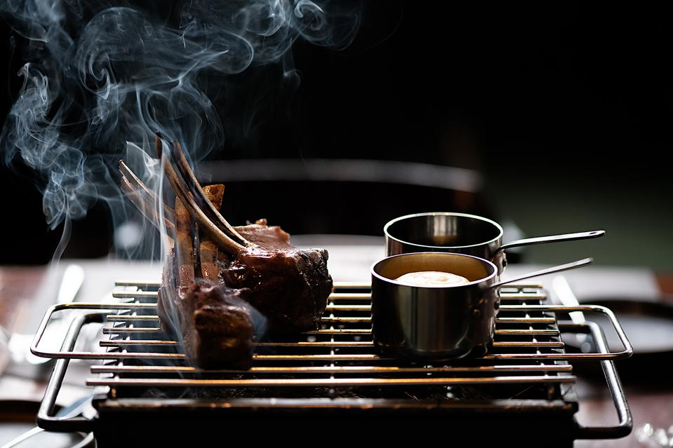 Grilled meat is on the menu at Basque restaurant in Lisbon, Portugal